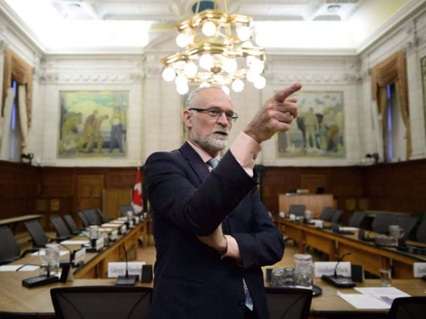 Auditor General Michael Ferguson waits to testify before the House of Commons public accounts committee on his spring audit of the government's employment