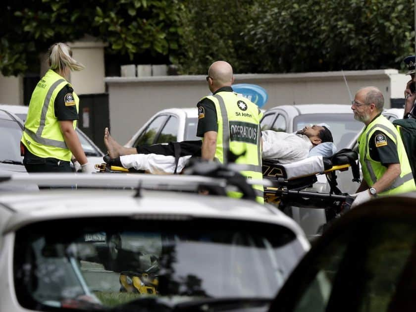 Ambulance staff take a man from outside a mosque in central Christchurch