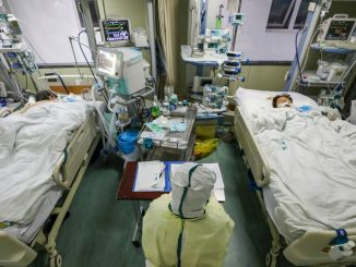 China's virus death toll surpasses SARS but new cases fall
